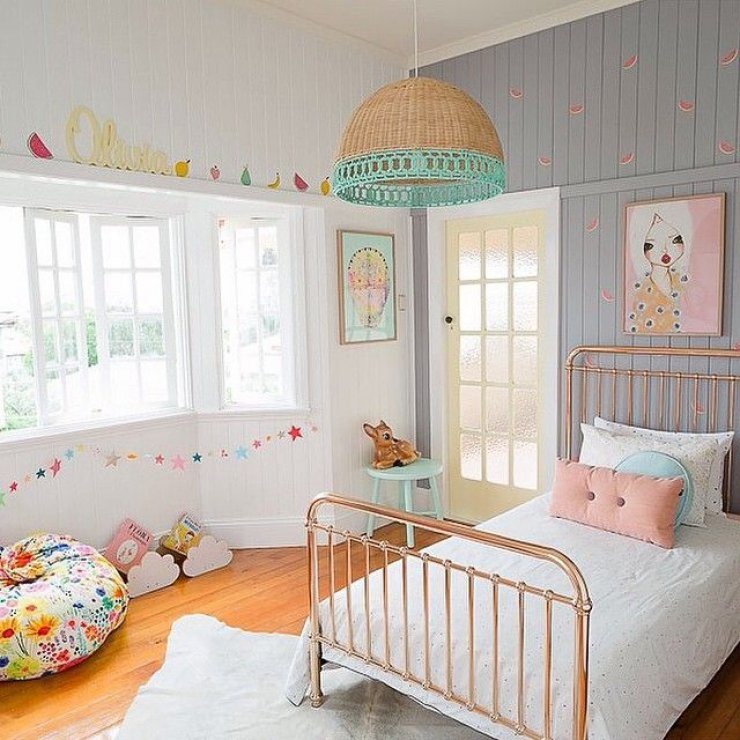 bright girls room with copper bed