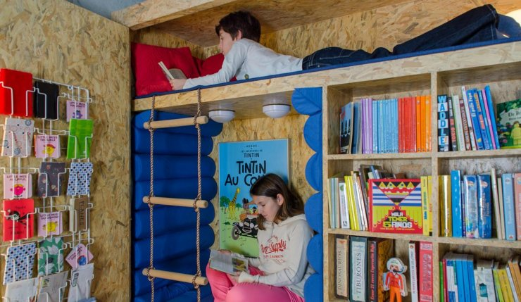 wardrobe hiding a reading nook for kids