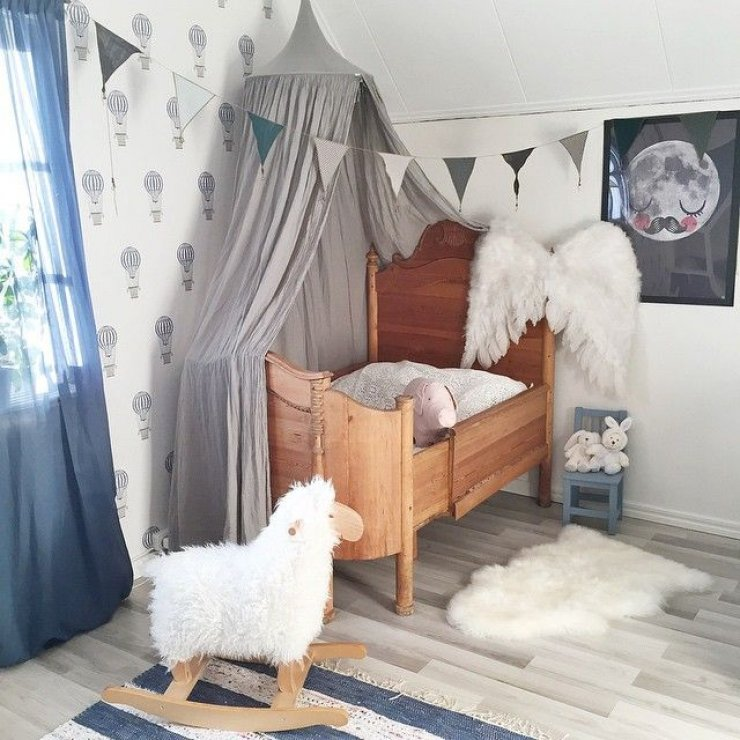 grey canopy and wings in a girls room