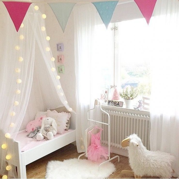 soft pink and light garland in a girls room